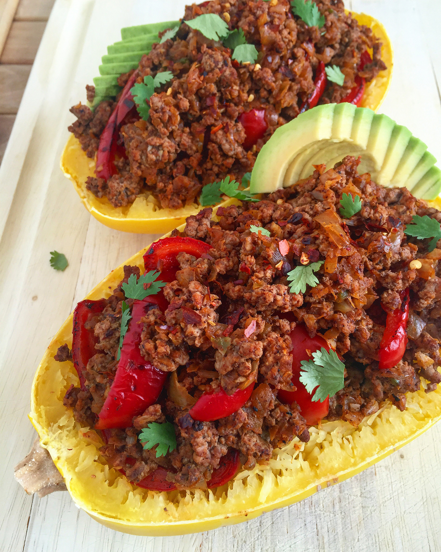 Spicy Spaghetti Squash Beef Bowl: pastured ground beef mixed with veggies and spices packed into a squash for a healthy, seasonal presentation. #paleo #healthy #glutenfree | Fresh Planet Flavor