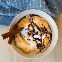 This easy Pumpkin Cinnamon Roll N'Oatmeal makes a delicious holiday alternative to oatmeal for breakfast, snack, or treat. :) GrokGrub.com