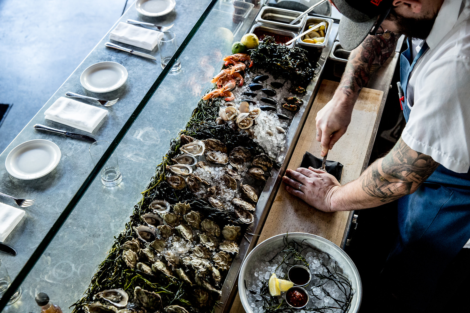 Oysters being shucked at the Boxing Room in San Francisco. (Photo Credit: Eater SF)