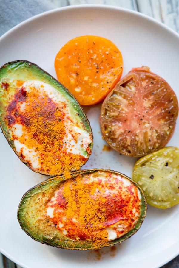 Three Ingredient Moroccan Eggs in Avocado - 12 Fresh Avocado Recipes   GrokGrub.com