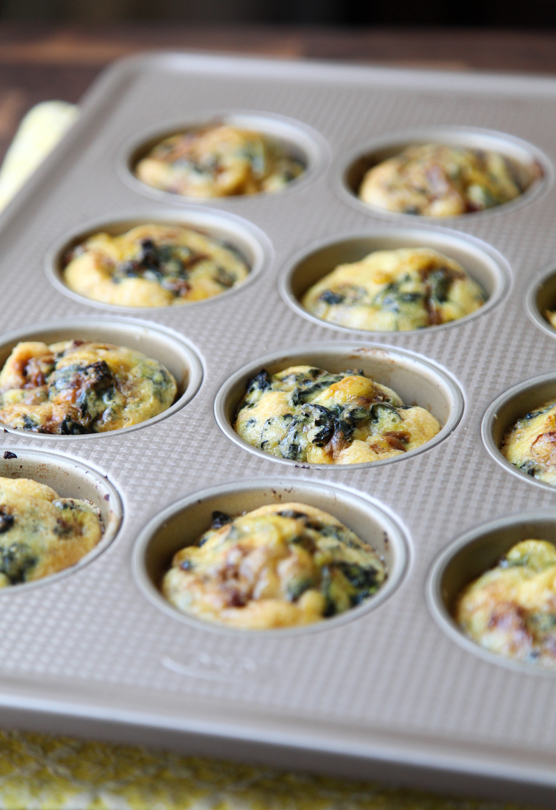 Grab-and-Go Egg Muffins: Basic name, not-so-basic flavor thanks to kale and CARAMELIZED ONION, people.